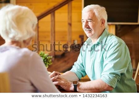 Kochliwy starszy człowiek patrząc żona rozmowy Zdjęcia stock © pressmaster