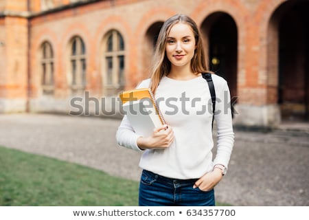 College student in jeans smiling Stock photo © nyul