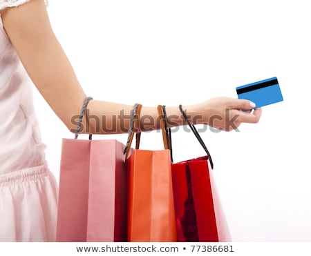 Love to shopping. Woman hands with purchase Stock photo © serdechny