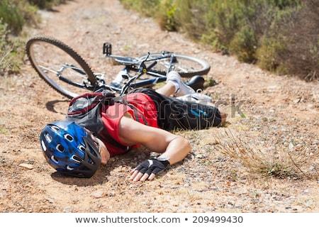 Man ongeval mountainbike grond weg landschap Stockfoto © AndreyPopov