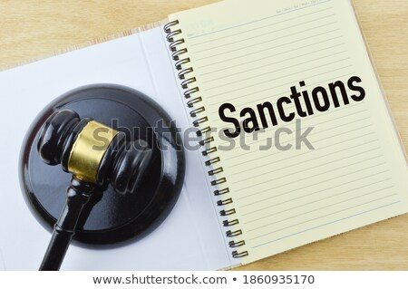 A gavel and a name plate with the engraving Business law Stock photo © Zerbor