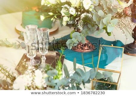 diamond ring, champagne and flowers on table Stock photo © dolgachov