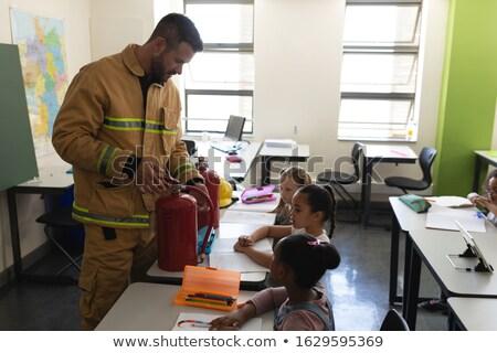 Vista lateral masculino caucasiano bombeiro ensino Foto stock © wavebreak_media
