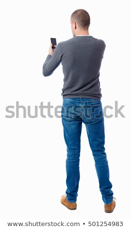 young man showing phone call gesture over grey Stock photo © dolgachov