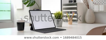 Home office workplace with keyboard and supplies Stock photo © karandaev