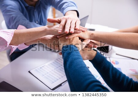 Group Of Businesspeople Stacking Hands Over Desk In Office Stock photo © AndreyPopov