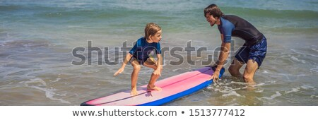 BANNER, LONG FORMAT Father or instructor teaching his 5 year old son how to surf in the sea on vacat Stock photo © galitskaya
