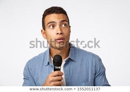 Meglepődött fiatalember stop beszéd hall furcsa Stock fotó © benzoix