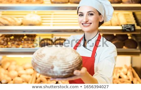 Elarusítónő kötény bemutat friss kenyér pékség Stock fotó © Kzenon