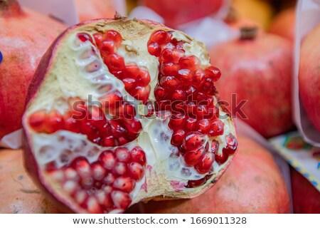 Ripe juicy fruit pomegranate close-up in cutannmo form Stock photo © ElenaBatkova