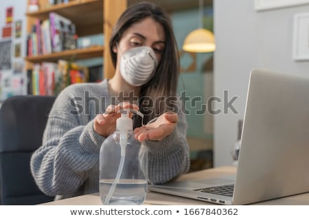 woman with corona mask protecting her from covid 19 stock photo © kzenon