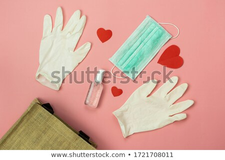 Table top view of Coronavirus protection, medical protective masks, gloves, hand sanitizer Stock photo © Illia