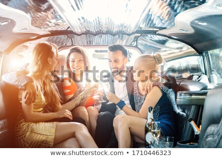 Crowd of party people in a limo with drinks Stock photo © Kzenon