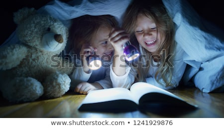girls playing with torch in kids tent at home Stock photo © dolgachov