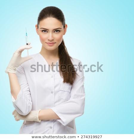 Mosolyog orvos injekciós tű kórház egészségügy gyógyszer Stock fotó © dolgachov