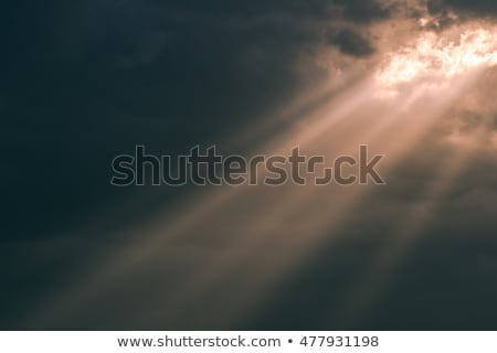 Sun Rays Beam through Dark Ominous Clouds stock photo © mackflix
