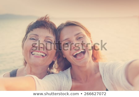 Mother and daughter at the beach Stock photo © photography33