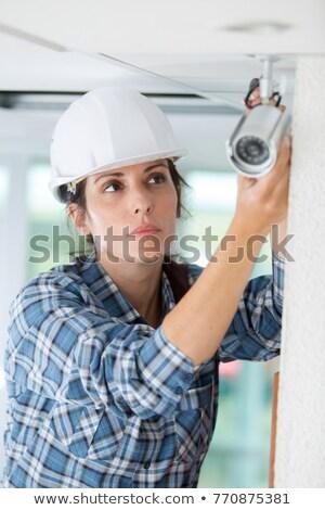 female technician watching an electronic circuit Stock photo © photography33