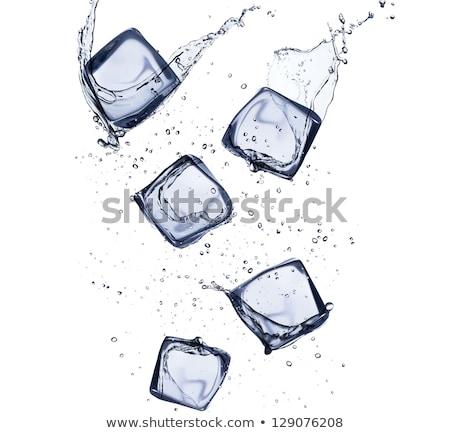 Jégkockák jeges víztükör csésze üveg víz Stock fotó © lunamarina