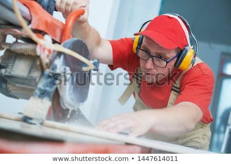 Budowniczy cięcie cegieł rozmiar biuro budynku Zdjęcia stock © photography33