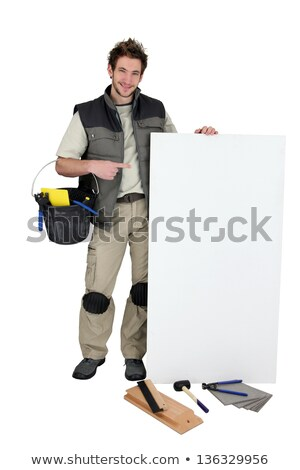 Tiler pointing at blank advertising panel Stock photo © photography33