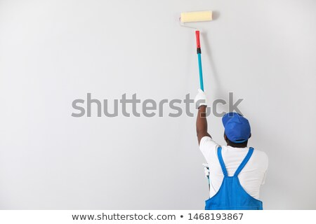 Decorator painting a room white with a roller Stock photo © photography33
