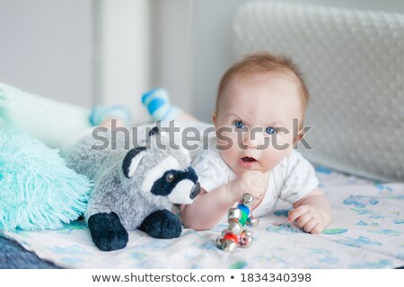 portrait of a cute newborn baby lying on the sofa in his bedroom stock photo © wavebreak_media