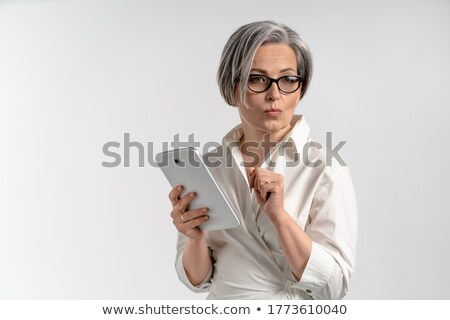 Portrait of a businesswoman showing keys with the camera focus on the keys stock photo © wavebreak_media