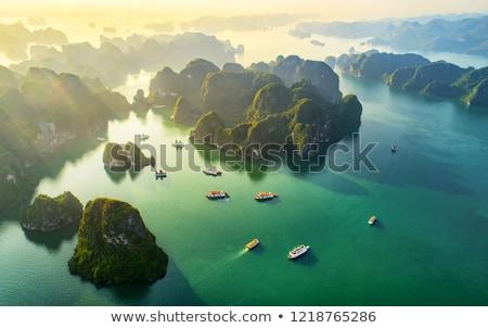 Vissersboot lang hemel water berg oceaan Stockfoto © michaklootwijk