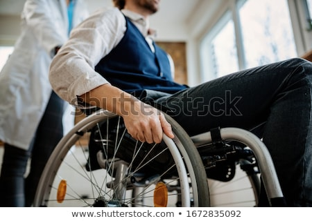 Nurse with disabled man in a wheelchair Stock photo © photography33