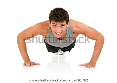 adult smiling man doing workout pushups isolated stock photo © juniart