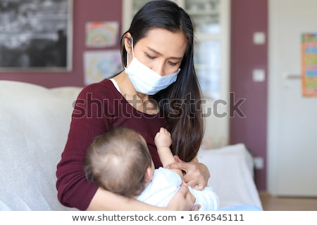 mother holding baby arms on her breast stock photo © lunamarina