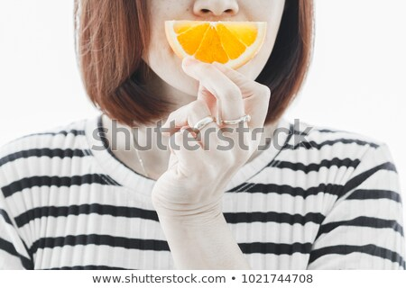girl eating a pice of orange stock photo © manaemedia