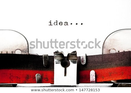 Script on Old Typewriter's Keys. Stock photo © tashatuvango