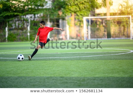 cute cartoon boy playing soccer stock photo © digitaljoni