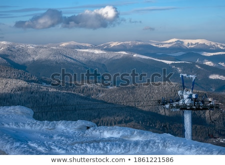 ski slope and storm clouds in evening stock photo © bsani