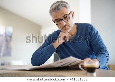 Stockfoto: Man · lezing · krant · knap · jonge · man · gezicht