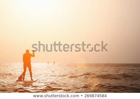male stand up paddler on lake stock photo © pixelsaway