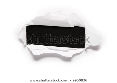 Stock photo: the sheet of paper with the rectangular hole against the black background