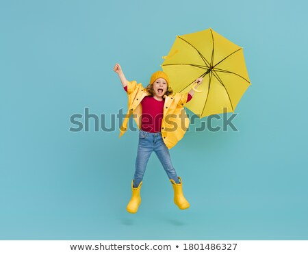 jumping with umbrellas Stock photo © ongap