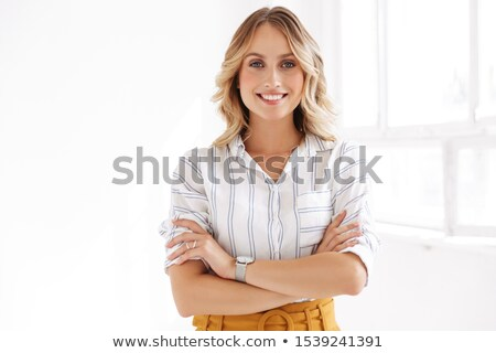 Gorgeous seductive young woman standing with arms crossed  Stock photo © deandrobot