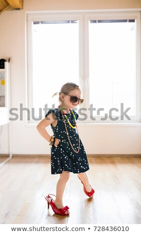 Cute blonde on high heels Stock photo © konradbak