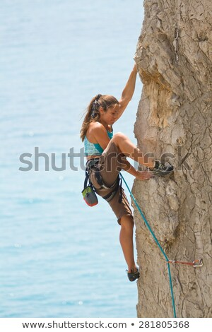 Rock climber rappelling. stock photo © gregepperson