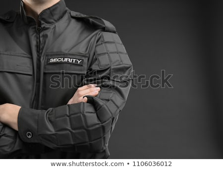 Homme uniforme sécurité fusil Photo stock © AndreyPopov