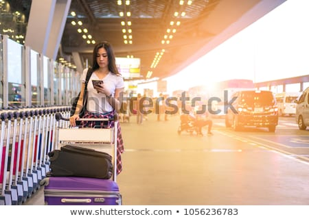 Stock photo: Traveling Girl with trolley bag