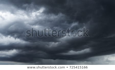 Heavy rain clouds Stock photo © artjazz