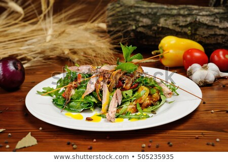 duck salad pumpkin and parmesan on a wooden background stock photo © kalinich24