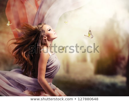 Stock photo: Beautiful young woman in dress from butterflies