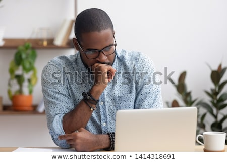 Stock photo: Head shot of man thinking