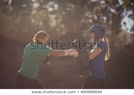 Determined women practicing boxing during obstacle course Stock photo © wavebreak_media
